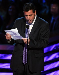 Adam Sandler giving his awkward speech from a piece of paper