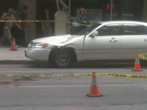 Lincoln Towncar that he hit then where he landed in the street