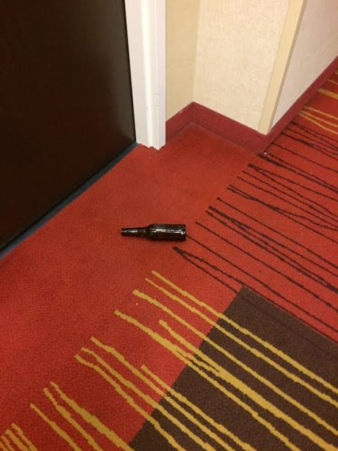 Someone else at our hotel had a bit of fun...no idea where this empty beer bottle came from outside our neighbor's room...